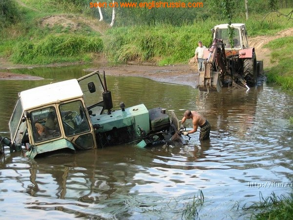 russian tractor deep in the water
