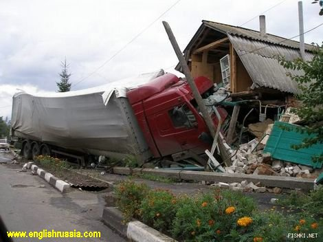 Home delivery: truck smashes into wooden house