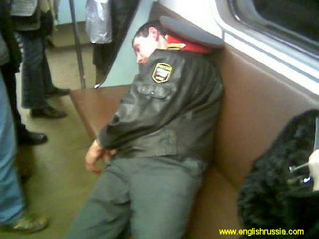 russian police officer sleeping in moscow city subway