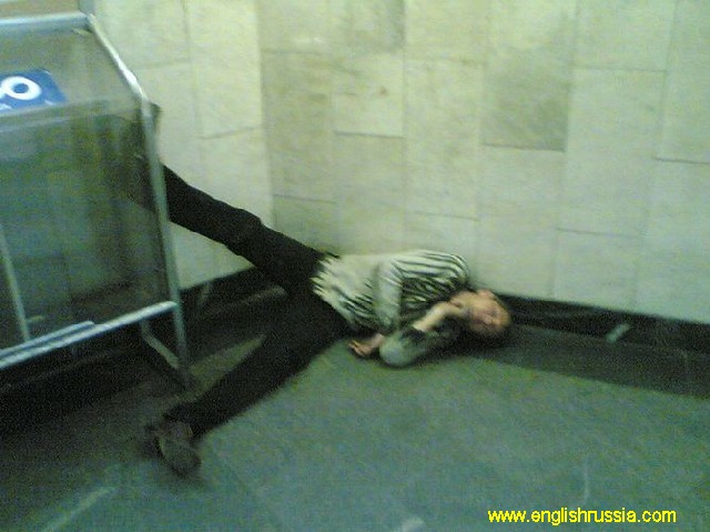 man sleeping in subway station, moscow city