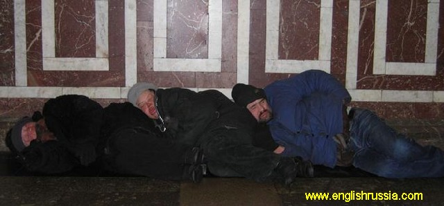 three guys sleeping in moscow city subway