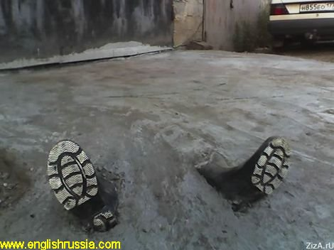 Two boots jut out the concrete poured parking floor – mafia victim? (photo)