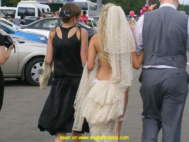 russian bride in a strange wedding dress - rear view